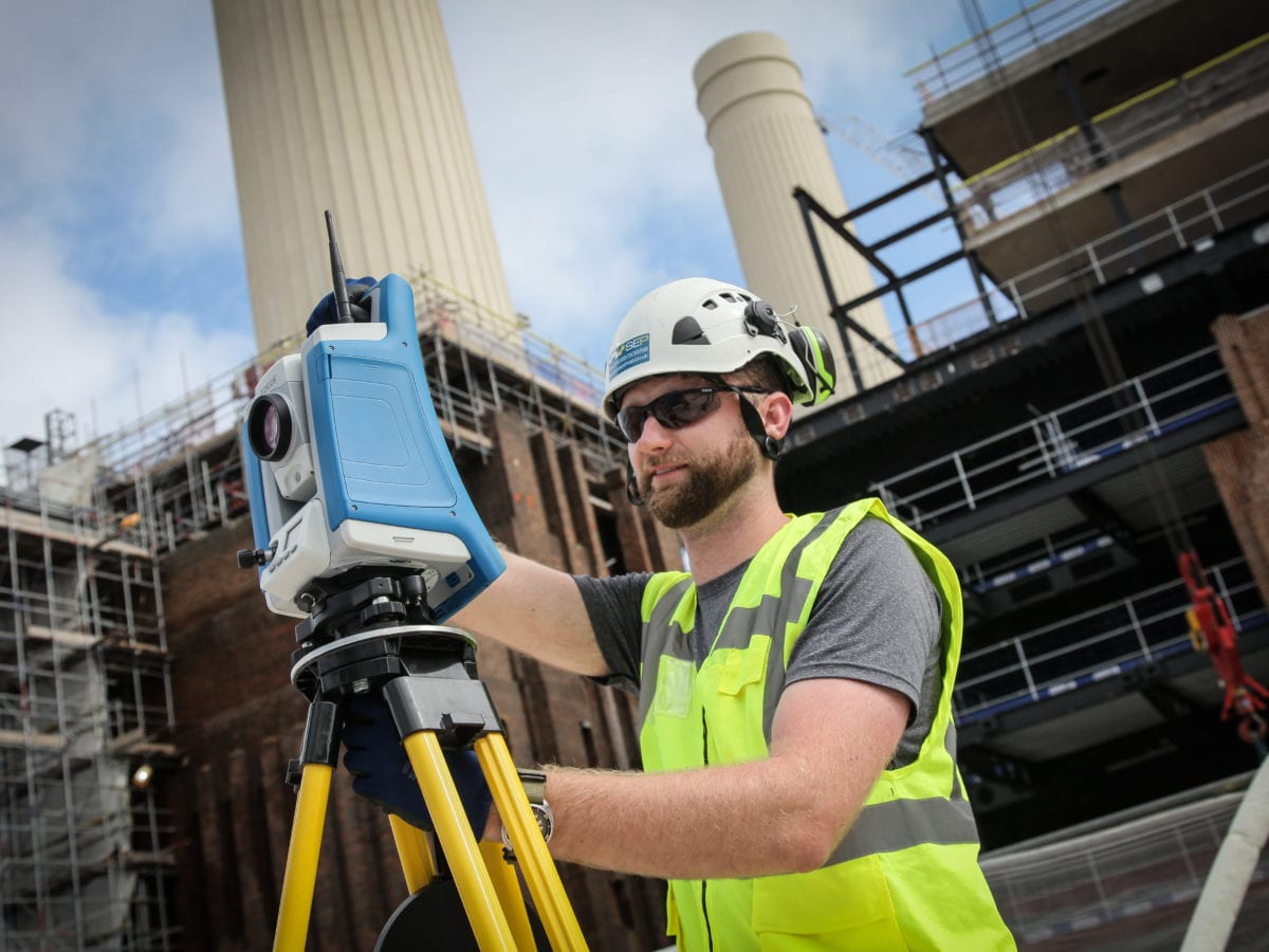 Surveyor using Spectra Total Station