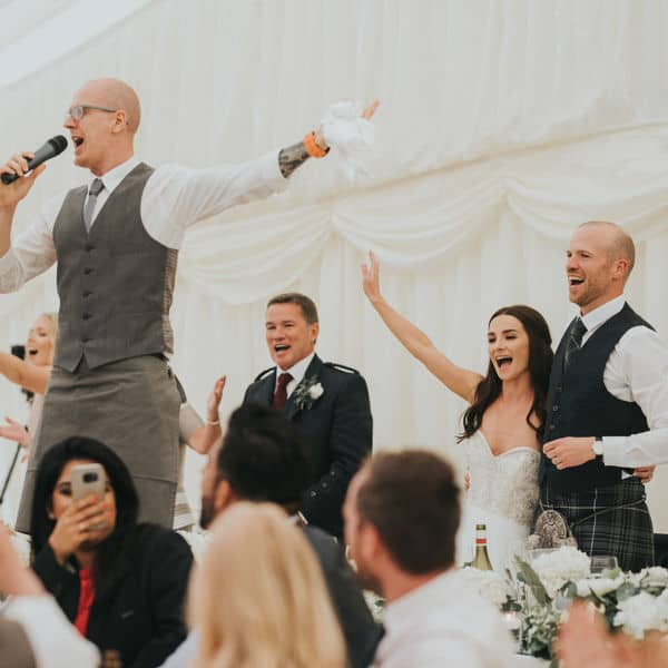bride dancing with singing waiters at wedding
