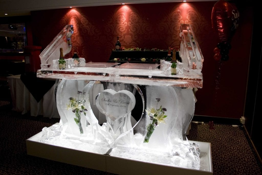 Wedding flower ice bar sculpture with luge