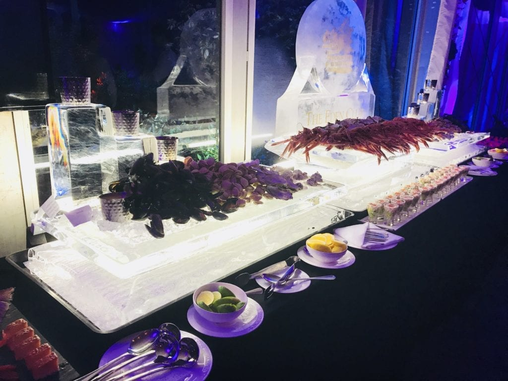 Seafood chilling on wedding ice sculpture